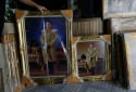 Pictures of Crown Prince Maha Vajiralongkorn are displayed for sale at a royal memorabilia shop while Thailand's parliament is set to announce his ascend to the throne after revered King Bhumibol Adulyadej passed away on October 13, in Bangkok, Thailand, November 29, 2016.  REUTERS/Jorge Silva