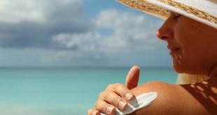 39968882 - girl aplying  sun protection cream on the beach