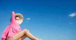 Woman sunbathing on a tropical jetty